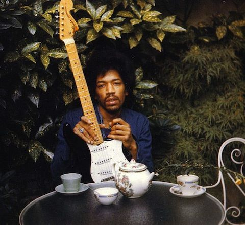 """Jimi Hendrix    Monika Dannemann, Jimi Hendrix's girlfriend, snapped the last photographs of the legendary electric guitarist with his favorite instrument, nicknamed """"Black Betty."""" They were captured the day before his death. This is one of multiple photos published in Dannemann's book, The Inner World of Jimi Hendrix. The musician looks somber in the image, but others in the rare series show him dreamily wandering with Betty in the garden behind Dannemann's London apartment."""