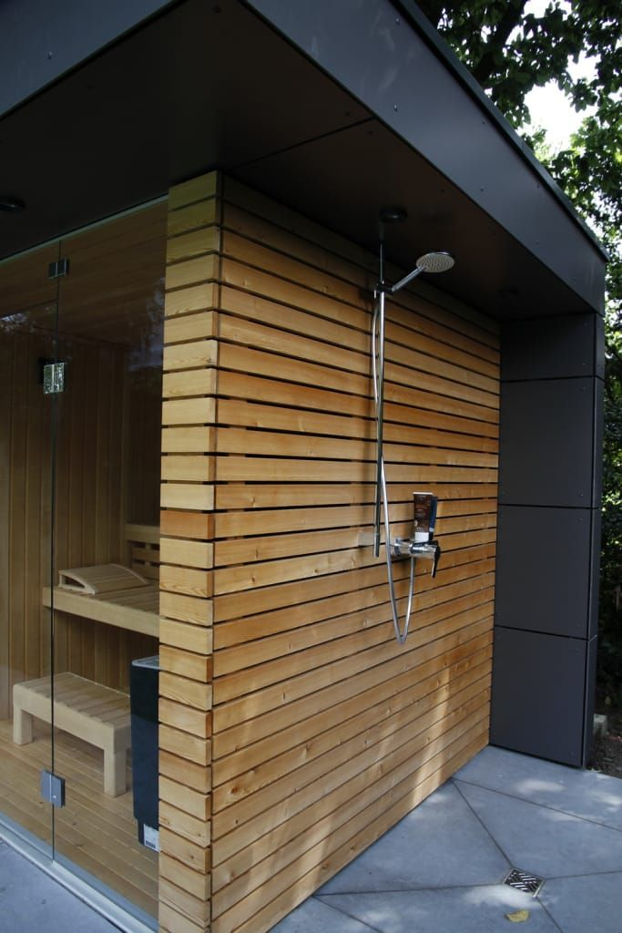 Garden sauna, garden shower, larch wood facade: garden house by garden protagonist