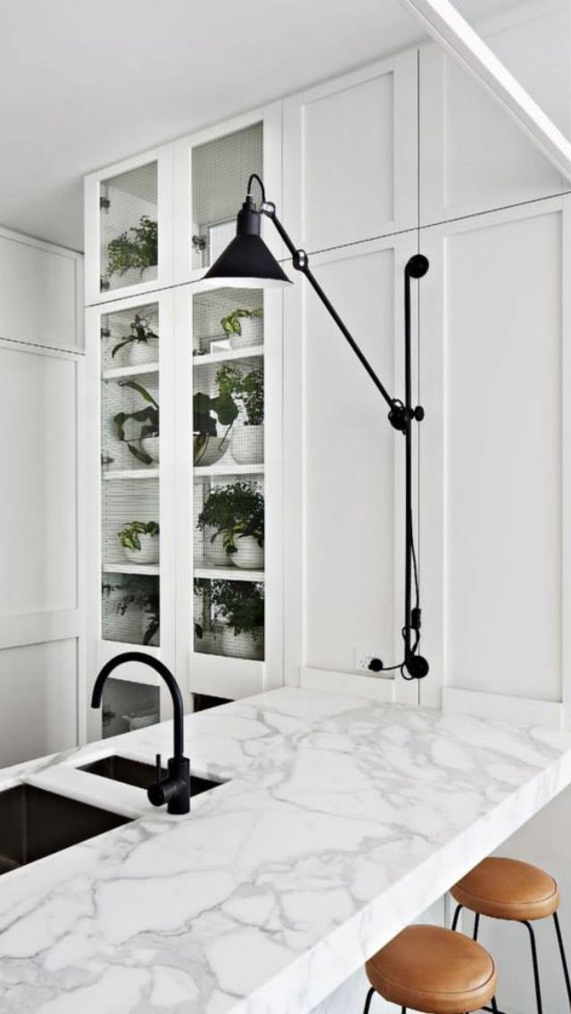 Black taps +  marble bench tops