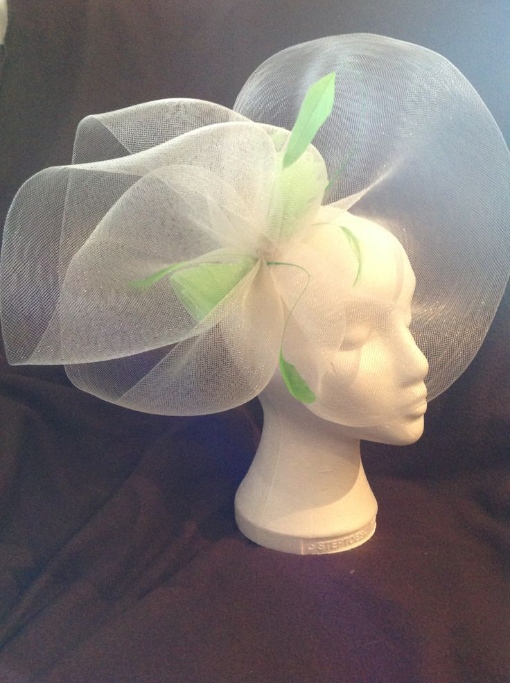 A fascinator by fascinators by Julie the Annette is an extra large fascinator on a buttermilk head band with large crinoline pleats surrounding a centre piece of two lime green crinoline roses with pearl detail and matching feathers to finish. $120 AUD. Found in the buttermilk collection on the website.