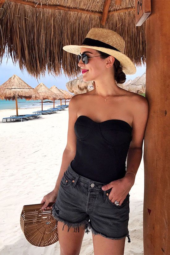 black strapless swimsuit, black distressed denim shorts, straw hat, black aviator sunglasses, bamboo clutch - Beach outfit, pool outfit, summer outfit, vacation outfit, getaway outfit, swimsuit outfit, swimwear outfit, summer fashion trends, summer fashion trends 2017, swimwear trends 2017.