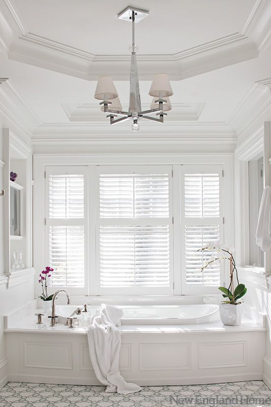 The master bath of a house in the suburb of Boston has a octagonal recessed ceiling that is accented by a fixture from Ailanthus. Photo by Robert Benson.