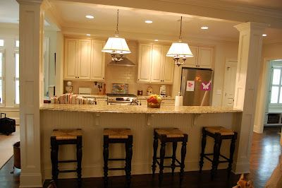 Half wall turned counter seating: wit seating reversed to the kitchen side