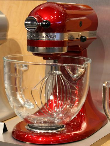The KitchenAid Tilt-Head Stand Mixer is always a classic, but we especially love it in the new metallic Candy Apple shade. #design #kitchenaid #mixer