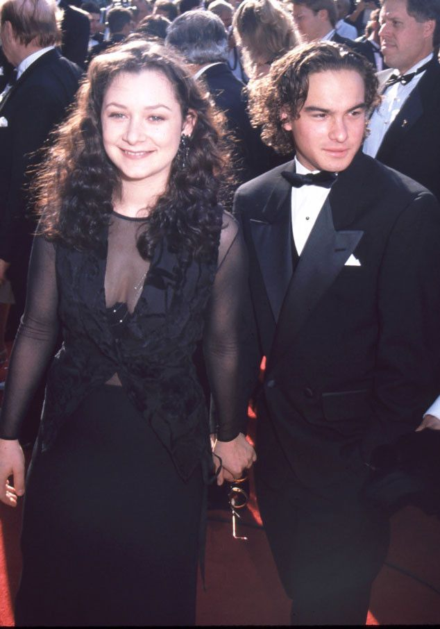 Sara Gilbert & Johnny Galecki from Emmys Cast Flashback  In 1994, the former Roseanne co-stars and couple held hands on the red carpet.