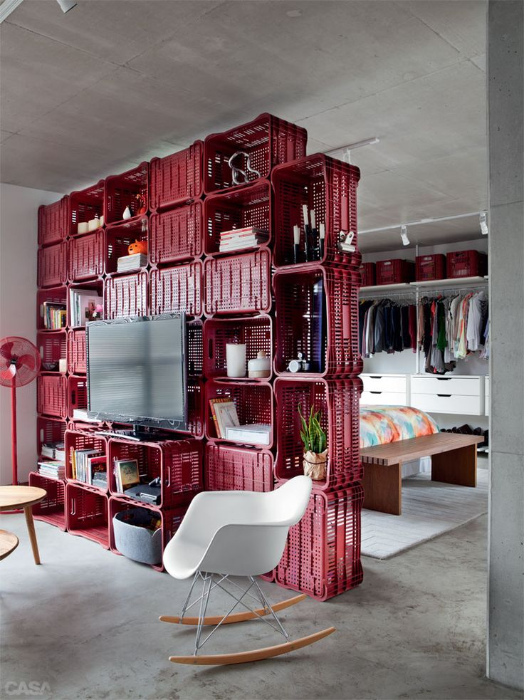 Crate room divider in this small studio.  Interesting and functional to separate the spaces.
