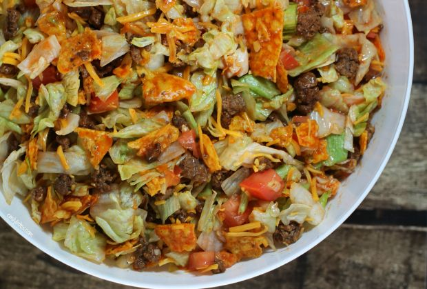 This Doritos Taco Salad is perfect for a potluck! Only 150 calories or 4 Weight Watchers points per serving!