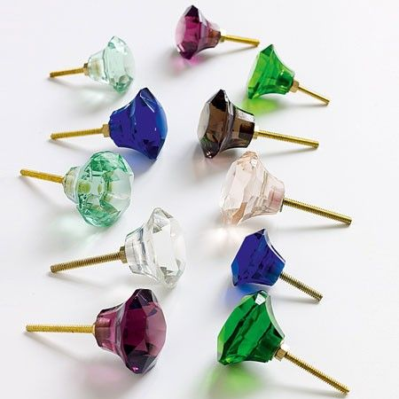 Coloured glass door knobs . . . intend to mismatch them throughout my flat