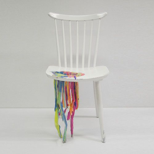 Her White And Wooden Chairs Are Drilled In The Corners And The Rainbow Of  Wet Paint Is Dripping Through The Holes.