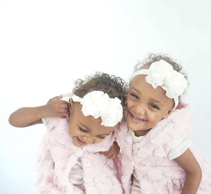 Identical twin sisters always giggling together