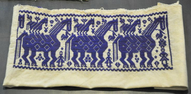 This embroidered panel was probably cut from a blouse.  Seen at El Museo Regional de Puebla, Mexico