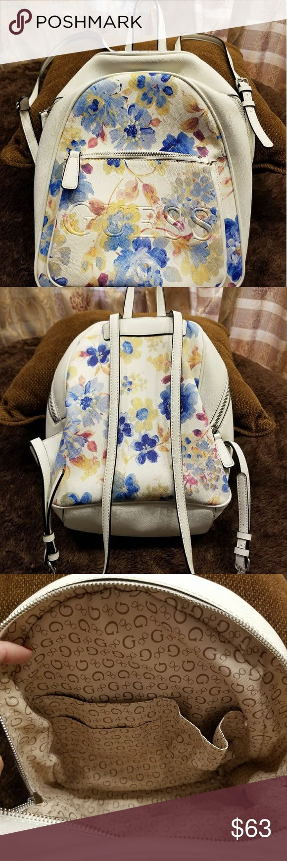 """GUESSWomen's White Backpack with Flowers-NWOT! GUESS Women's White Backpack with Flowers. New Without Tags!!! One outside pocket with zipper. Four inside pockets. 10.5"""" L x 12.5"""" H x 4"""" W. Guess Bags Backpacks"""