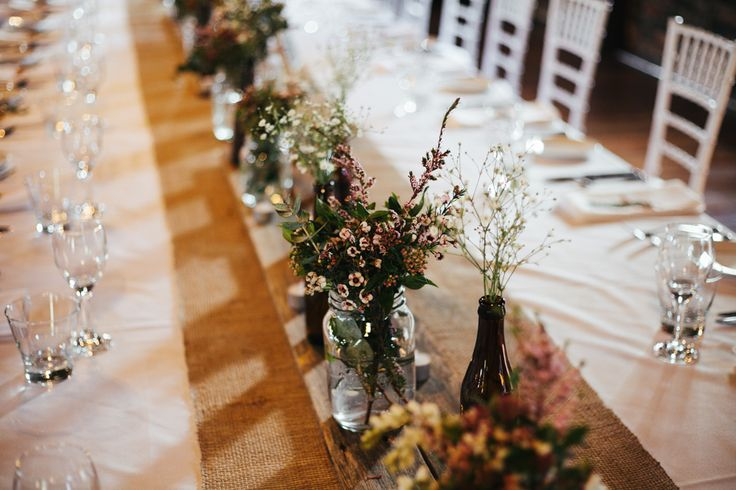 Our table setting. White linen with Hessian runner. We also added fence pailings down the middle to give it that rustic look.