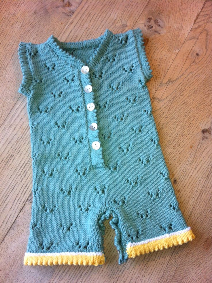 Knitted baby romper. I just changed the holes in the pattern to butterflies. Again from DROPS http://www.garnstudio.com/lang/dk/visoppskrift.php?d_nr=b1&d_id=9&lang=dk