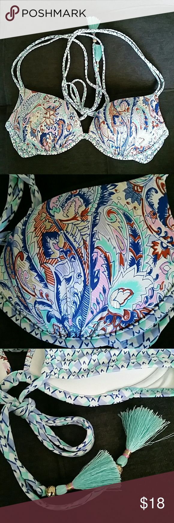 NWOT Victoria's Secret Bikini Top - 34A Never worn after the tags were cut off. Size 34A and heavily padded. Straps can be tied in multiple ways. Top only. Victoria's Secret Swim Bikinis