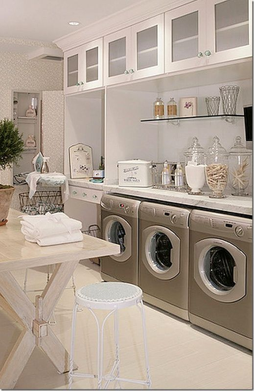 Great Laundry Room Design. #glass #cabinets #laundry #room #storage
