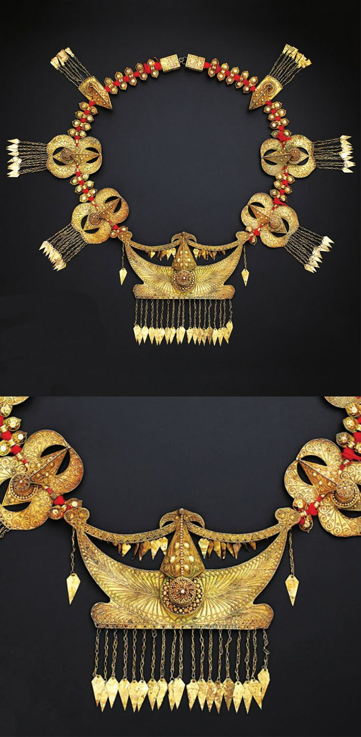 Indonesia | Protective necklace ~ 'bura-bura' ~ silver-gilt and red cord | Karo Batak | 20th century ||| Source; http://issuu.com/edmbooks/docs/preview_gold_jewellery