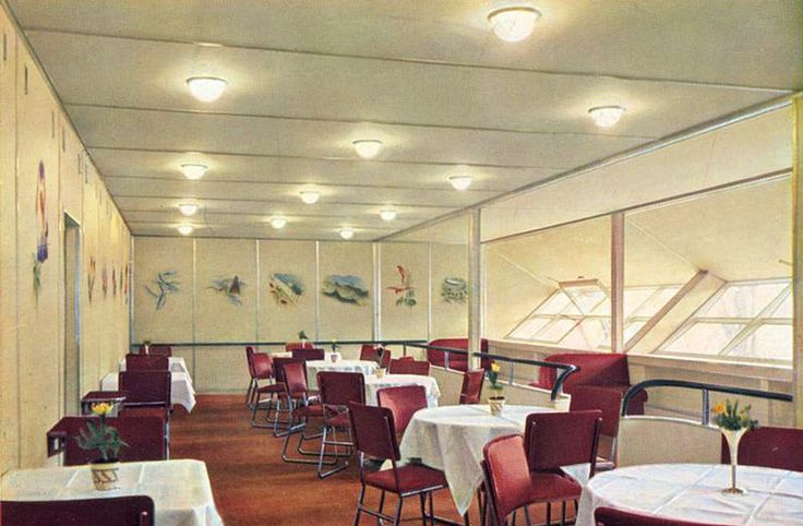 A color photograph of the dining room aboard the Hindenburg.