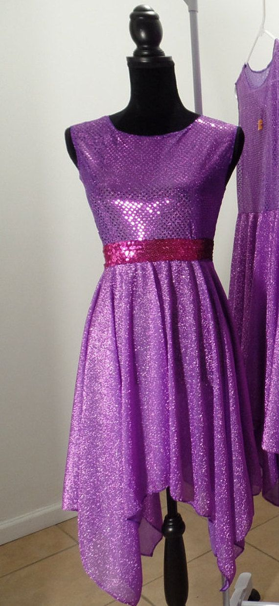 Beautiful Worship Dance Top.  Product Description:  Style: hankie dress top - Sleeveless Color: Purple NOTE : color may vary from the picture due to computer screen.  Fabric: Sparkling Sequin & America Knit  Available Sizes: XS- S-M-L-XL Adult Size 3-4-5-6 Children's Size This is a great addition to any outfit for a layered look (large circle skirt) (pants) or to add different colors to an outfit. *SIZE CHART*   SIZE ADULT XS S M L XL   BUST 31 ½ 32 ½ 34 36 38 SIZE CHILDREN'S 3 4 5 6 ____...