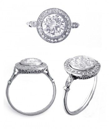 Antique Diamond Ring 1.12ct Platinum Diamond Ring Product Description: Platinum diamond engagement ring. Center diamond is approximately 1.12ct, H color, SI1 clarity. The center diamond is surrounded by a bezel of pave set diamonds in a fine platinum mounting.