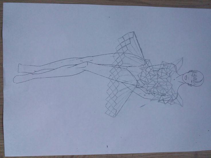 Definitieve ontwerp.  De bovenkant gemaakt van papieren 3d figuren en de onderkant van papier gevouwd in een waaier vorm. Onder de rok komt een versteviging van kippengaas.