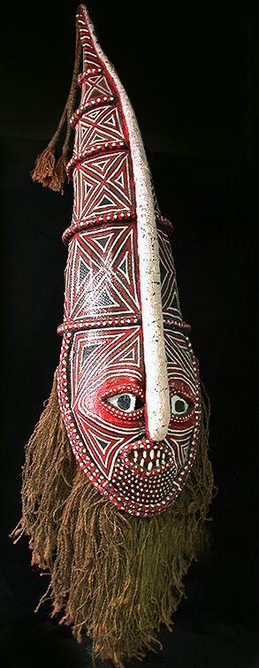 Chikunza mask Chokwe people, Angola/Zambia 44 inches, paint, resin, fabric, wood, rope