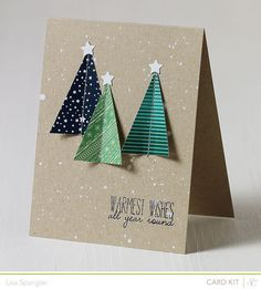 Triangle cut trees out of patterned paper; Mr Huey's opaque white for snow background on kraft. Pretty