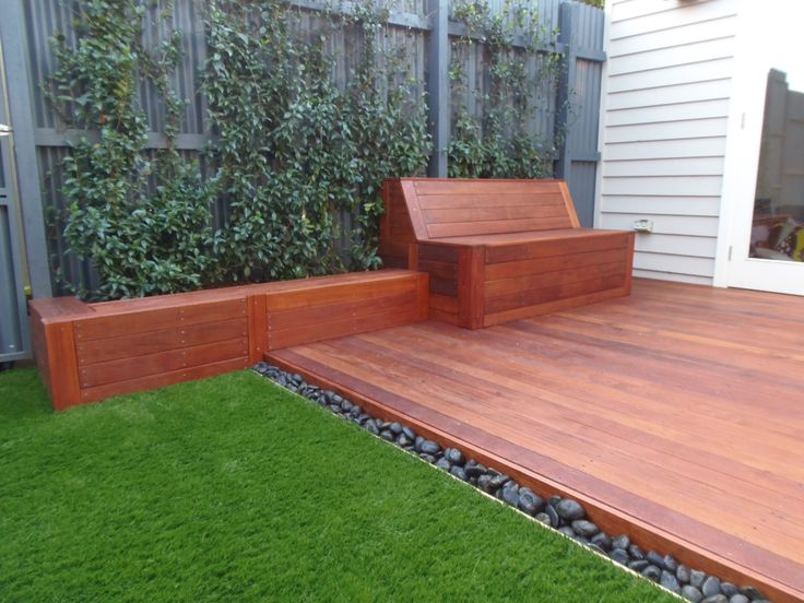 Small court yard brought to life with Merbau decking, a built in seat and synthetic turf.