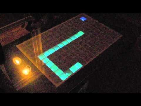 Arduino LED table demo. At the 1min mark it starts playing Tetris, theme song and all!