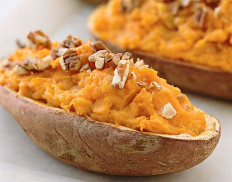 Twice-Baked Sweet Potatoes. 2 LG baked sweet potatoes (halved), 2 oz neufchatel cheese (cubed), 1 tbsp fat free milk, 1 tbsp brown sugar, 1/4 tsp cinnamon, 1/4 c chopped pecan (for garnish).