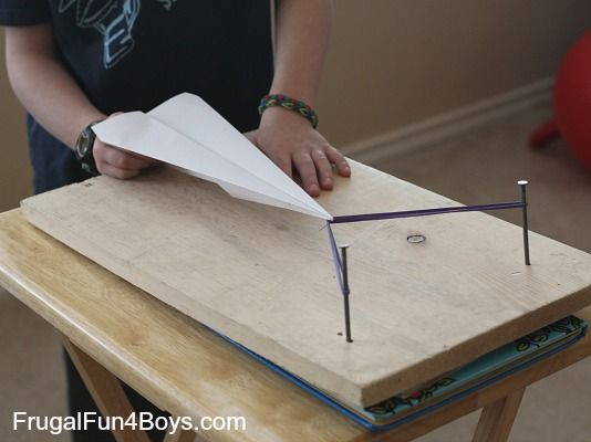 Paper Airplane Launcher - seriously, my older son would think this is great!