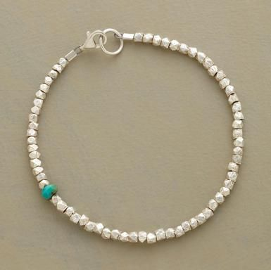 "A single rondelle of turquoise makes a surprise appearance among faceted sterling silver nuggets in a bracelet you'll want to wear every day. Made in USA. Exclusive. Approx. 7-1/4""L."