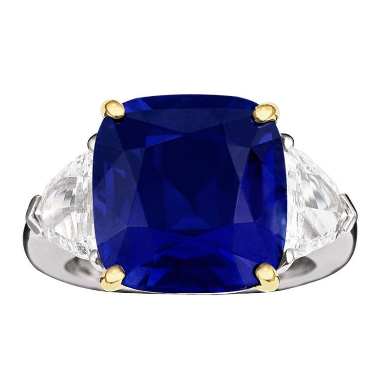 Natural Kashmir Sapphire & Diamond Ring - 14.44 carat Kashmir sapphire with 2 trapezoid diamonds weighing 2.08 total carats.  $2,250,000 from M. S. Rau Antiques in New Orleans, LA; shown at 1stdibs.com