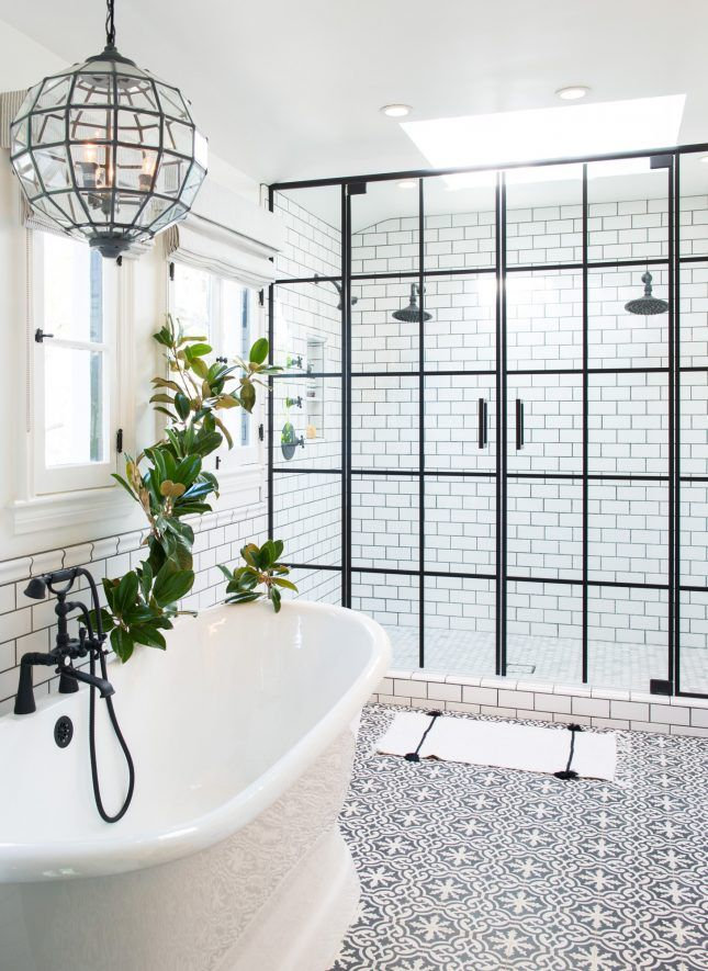 Combining multiple types of tiles promises to be a cool and simple way to get a totally custom bathroom. Pair a monochromatic palette for serious visual impact and play around with layers of subway, hex and square tiles for a cool bathroom makeover.