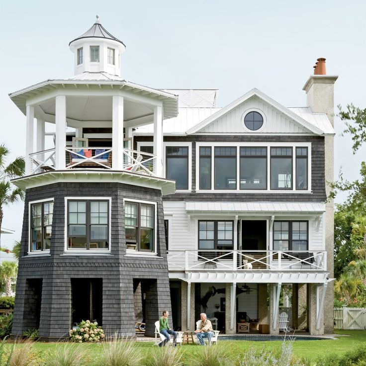 Tour This Lighthouse Inspired Home Beach House Design Beach House Decor Beach House Interior