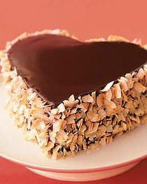 heart cake - would look so cute with tinted coconut in place of the nuts...
