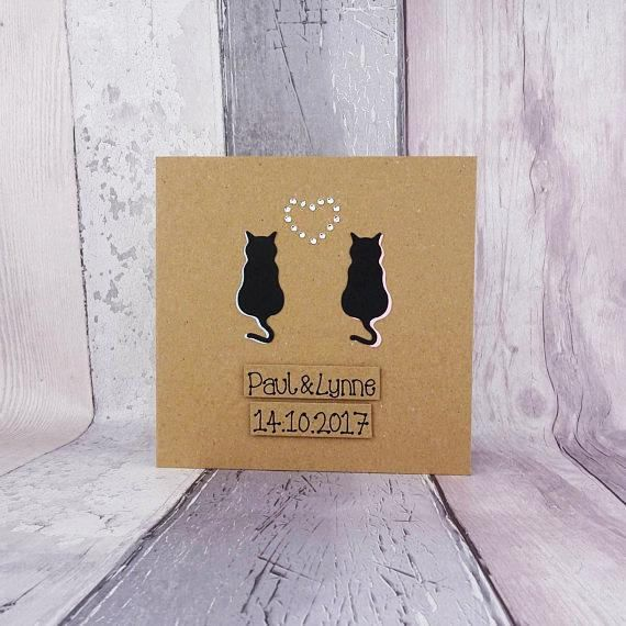 Handmade purr-fect cat couple handmade card. This card makes a fantastic engagement, wedding or congratulations card.  I also offer this card with Anniversary messages, which is listed here: https://www.etsy.com/uk/houldinghands/listing/531596383/cat-wedding-card-for-couple-handmade  This handmade pun card has the shadow of two cats with gems in the shape of a heart between them. You can choose the colour of the shadows on the two cats from the drop-down men...