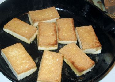 I have had MANY people ask me how I pan fry my tofu and get it so crispy and firm. There are a few reasons why:-). First I either use a non-stick or cast iron pan, I dont overcrowd the surface, I drain my tofu REALLY well, use only extra firm Chinese style and MOST important of all, I leave it undisturbed while cooking and this allows the golden crust we all love on pan-fried tofu to develop! Please find detailed instructions below on how to make the best pan-fried tofu ever!