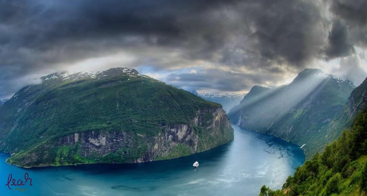 Geirangerfjord with cruise ship and The Seven Sisters waterfall on far right, Geiranger, Møre og Romsdal, Norway (© Karsten Bidstrup/Lonely Planet Images)