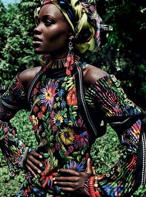 Lupita Nyong'o went back to her roots for Vogue's October cover. The Oscar winning actress celebrated her background by inviting the fashion magazine to her family home and farm in Kenya.  The photographs, shot by Mario Testino, show Nyong'o dancing with fellow Luo women in western Kenya and walking through Lake Victoria's Dunga Beach.