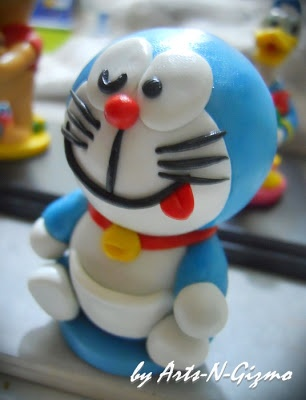 Doraemon figurine made from Polymer Clay. It can be a nice gift as well as a birthday cake topper for all those Doraemon lover.