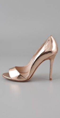 This would make an excellent wedding shoe.  Loke how they are cut in the front | rose gold wedding |  rose gold heels