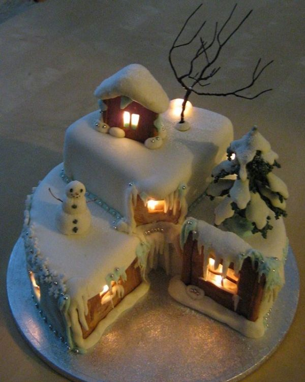 """One of the comments at the original posting site said this is made with a specific yellow cake plus coconut cream. It looks like fondant for much of the """"snow."""" But what do I know? :-) Oh, and the lights are rice lights. People say they are hard to find at Christmas."""
