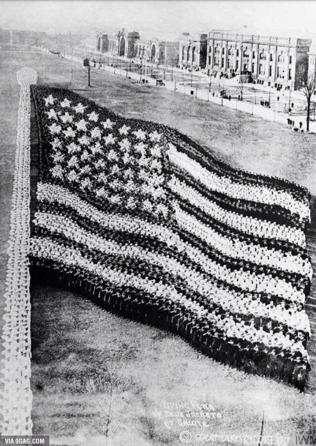Soldiers making American Flaf