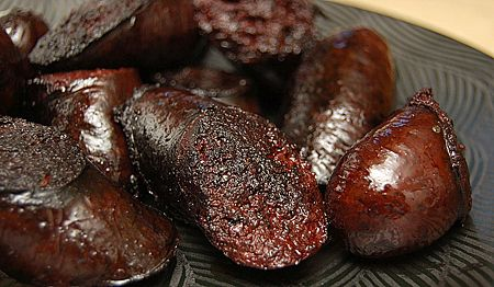 Yummy cooked blood sausages. Hope to make some of these soon. Very primal