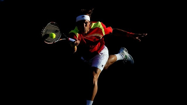 David Ferrer of Spain plays a forehand during the Men's Singles Tennis match against Vasek Pospisil of Canada on Day 2 of the London 2012 Olympic Games at the All England Lawn Tennis and Croquet Club in Wimbledon on 29 July.