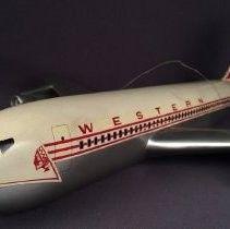 """Model AirplaneWesternAirlinesBoeing 720B, N93141 model airplane in Western's """"Indian Head"""" livery."""