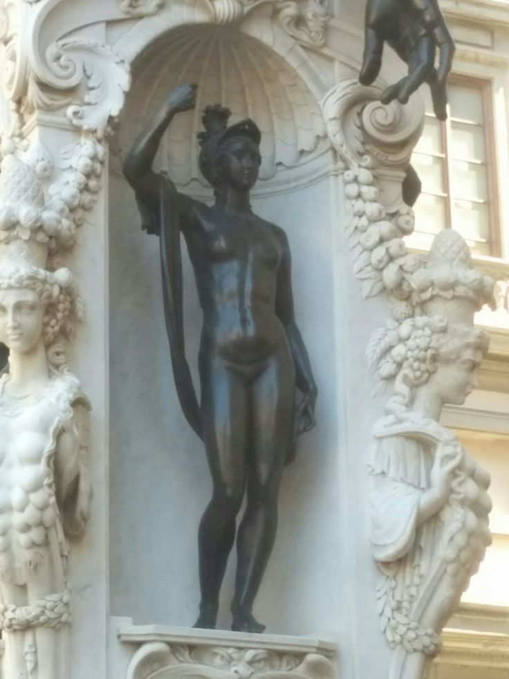 The last of the three statues in the base of the Perseus statue.