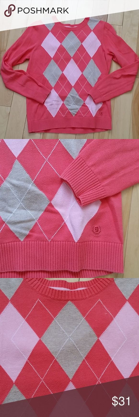 IZOD CORAL CREWNECK SWEATER WOMENS IZOD Womens sweater. The color is coral, pink and toupe. Soft material.  Size medium. Izod Sweaters Crew & Scoop Necks
