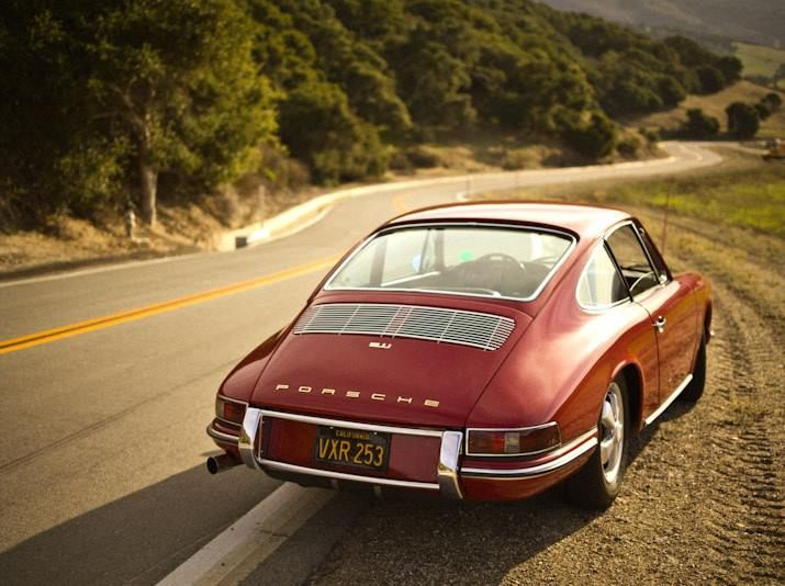 Early, twin-grille, black plate 911, and a twisty road.